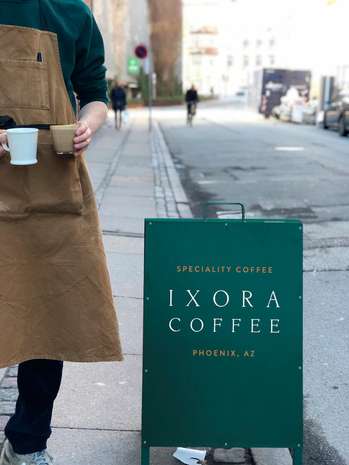 Ixora-Coffee-branding-and-Logo-on-coffee-board-Wild-Bear-Designs